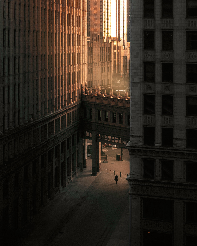person-walking-on-street-between-buildings-3617457